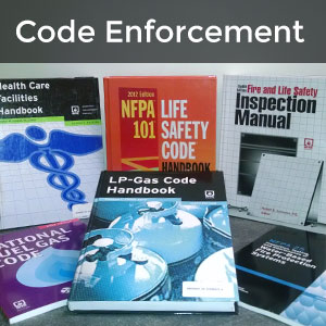 Code Enforcement - books on desk